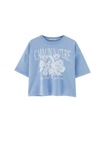 T-shirt bleu imprimé marguerites
