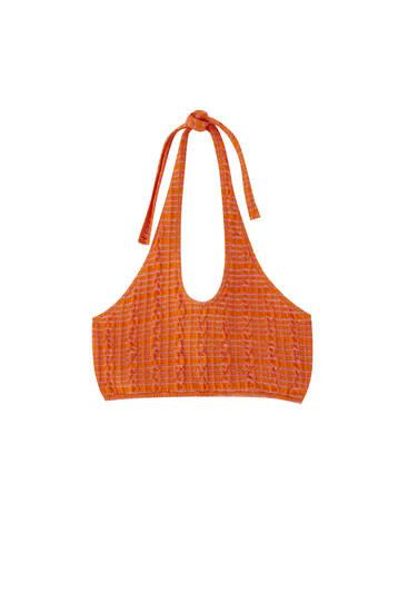 Orange halter neck crop top