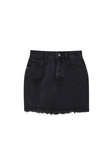 Denim mini skirt with rips and a frayed hem