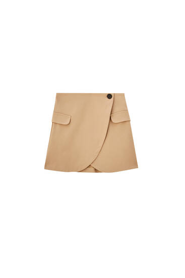 Crossover buttoned mini skirt with pockets