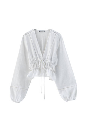 White oversize blouse with lace trim