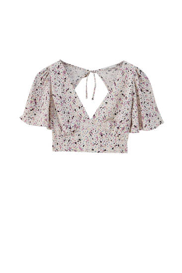 Print top with cut-out detail