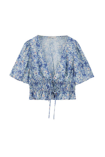 Printed cropped blouse with bow detail