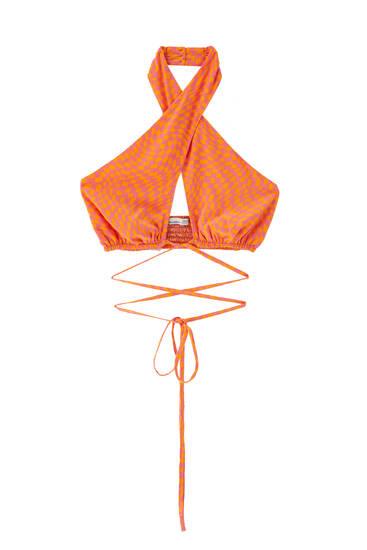 Orange slå om-top med stropper