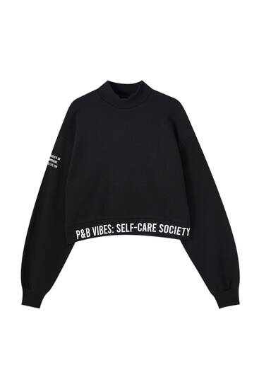 Cropped sweatshirt with slogan on hem