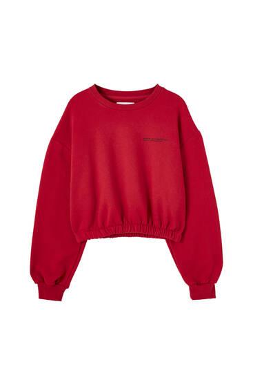 Red cropped sweatshirt with elastic hem