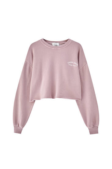 Cropped pink embroidered slogan sweatshirt