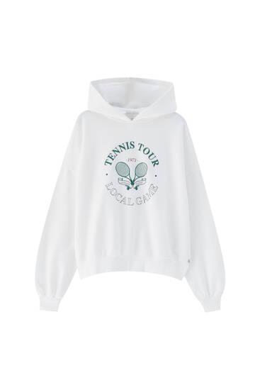 White sweatshirt with tennis graphic