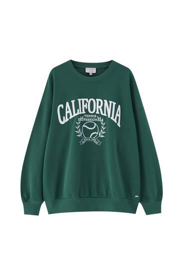 Green sweatshirt with tennis graphic