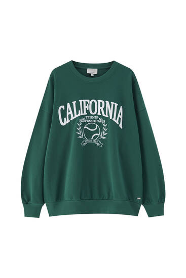 Green sweatshirt with tennis graphic