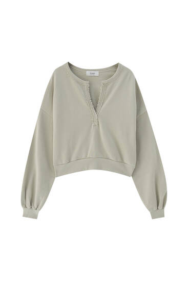Cropped henley neck sweatshirt