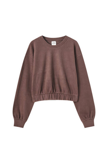 Brown sweatshirt with elastic hem