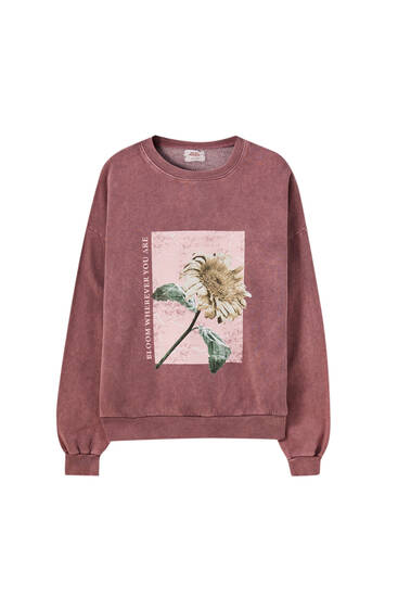 Faded pink sweatshirt with a floral print