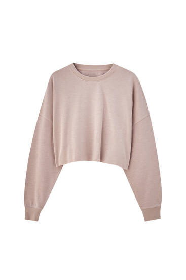 Pink sweatshirt with piped seams