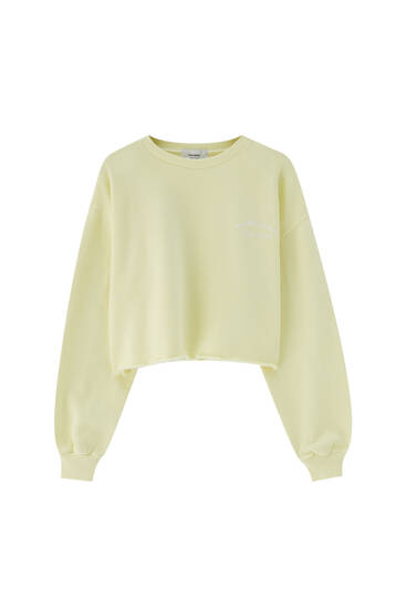 Cropped yellow sweatshirt with embroidery