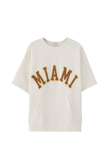 Kortärmad t-shirt text college