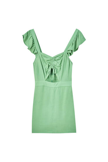 Green playsuit with ruffled straps
