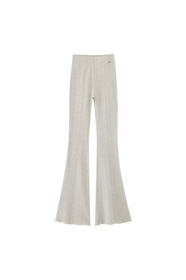 Textured flare trousers with lettuce-edge detail - Contains recycled cotton