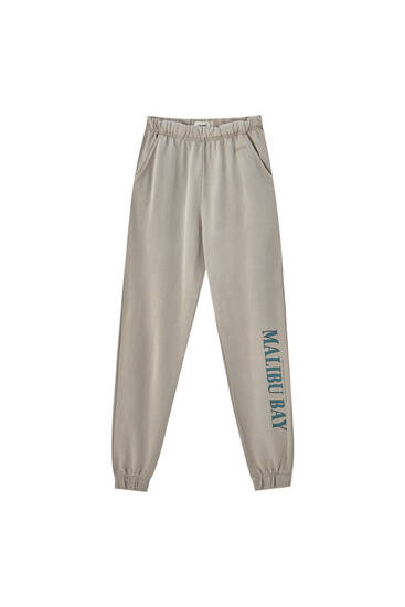 Faded jogging trousers with elastic hems