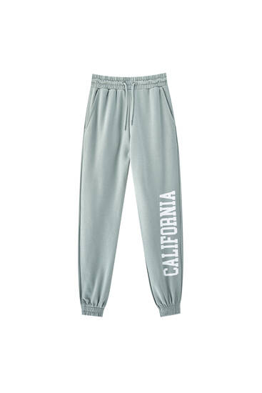 Pantalon jogger inscription jambe