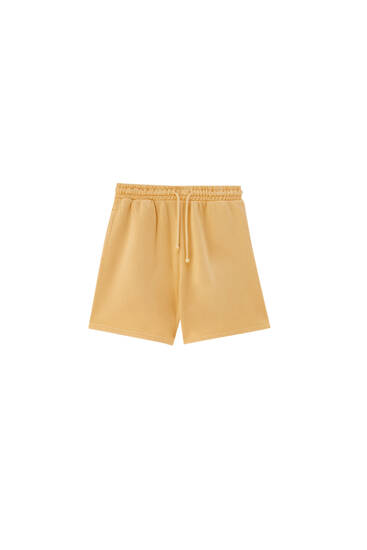 Faded-effect orange shorts - ecologically grown cotton (at least 75%)
