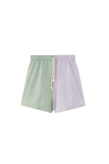 Green and mauve panel Bermuda joggers