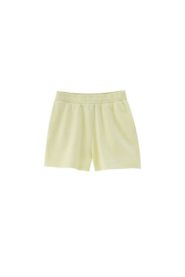 Embroidered yellow Bermuda shorts