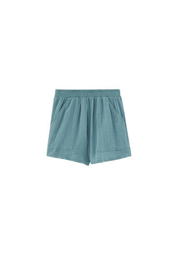 Green Bermuda shorts with elasticated waistband