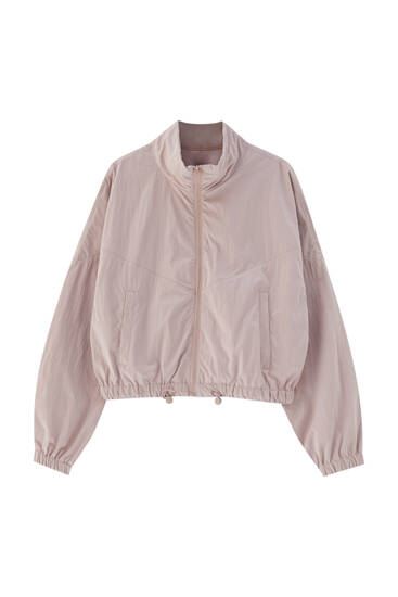 Rosa jacka med fickor