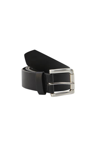 Black belt with a metallic buckle