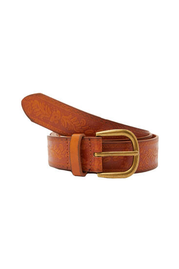 Embossed belt with a metallic buckle