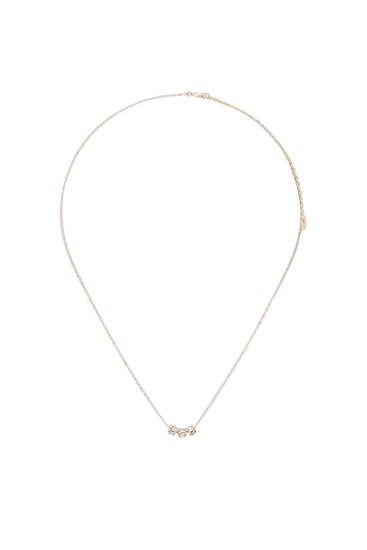 Gold-toned necklace with rhinestone pendant