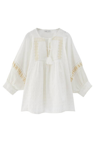 Oversize blouse with contrast embroidery