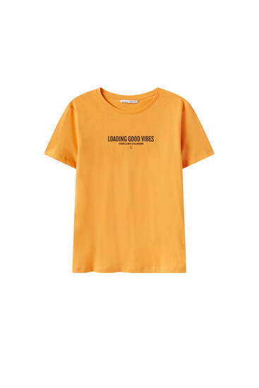 T-shirt with graphic and slogan