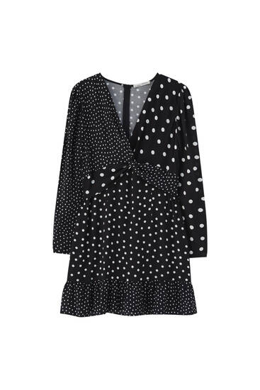 Flowing polka dot dress with ruffle trim