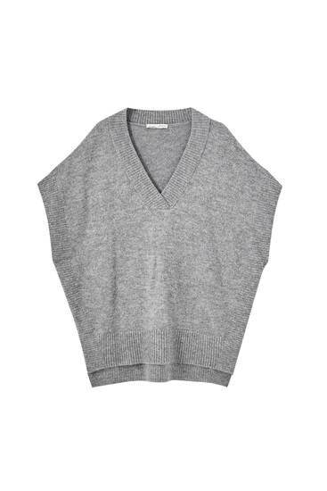 Knit vest with cut-out details
