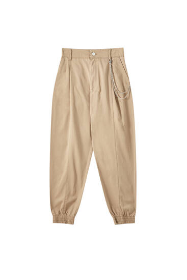 Pleated trousers with chain detail