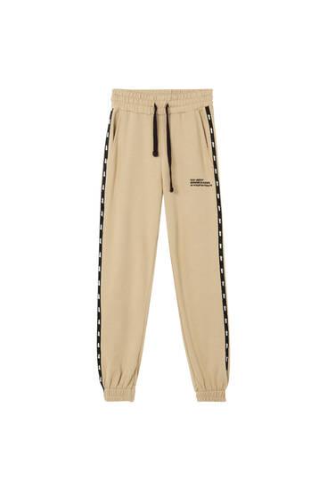 Pantalón jogger STWD bandas