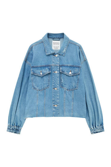 Denim jacket with elastic detail at the back
