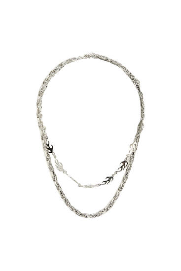Pack of silver-coloured flame necklaces