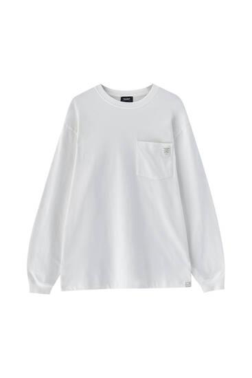 T-shirt oversize de manga comprida com bolso