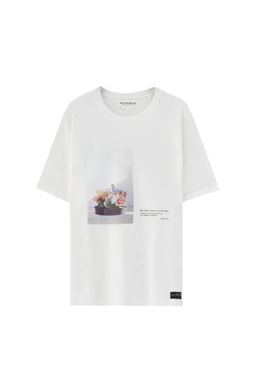 White T-shirt with graphic and slogan