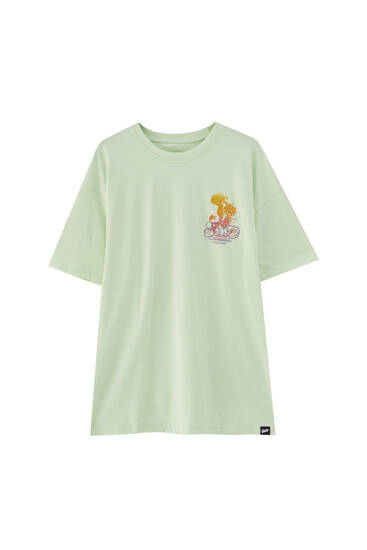 Lime green T-shirt with contrast mushroom illustration