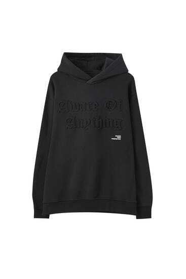 Black hoodie with raised slogan