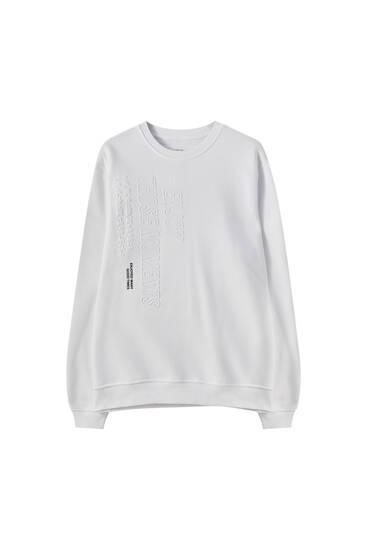 White sweatshirt with raised detail