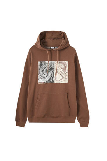 Brown hoodie with illustration