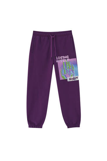 Joggers with purple slogan