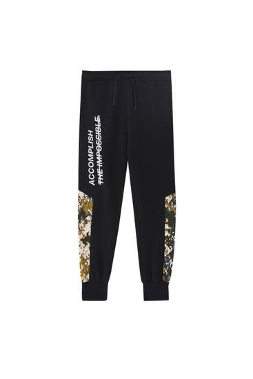 Black joggers with print detail