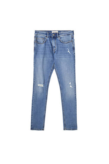 Jeans súper skinny azul oscuro rotos