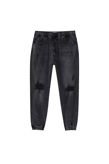 Black jogger jeans with rip details